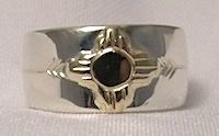Zia sun ring in gold on silver with arrows