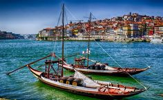 #TroveOn - Rabelo boats with the beautiful city of Porto on the background. The Rabelo boat is a tradition in Portugal. Native from the Douro region, it does not exist in any other place of the world. Its history is linked to the production and trade of port wine. Discovered by I'm Out of the Office at Oporto, Porto, Portugal