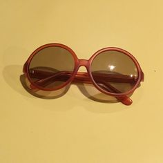 Kate Spade sunglasses Selling a very cute retro style of Kate Spade sunglasses. These are from the Kate Spade Saturday Let Loose collection. They are and amber/red color and round style. So cute and unique!!! kate spade Accessories Glasses