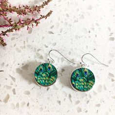 These beautiful, vibrant, peacock print earrings are handmade on wood, using scratch-proof ink. Drop earrings | statement jewellery. Check out all our designs at http://www.etsy.com/shop/lovebirdaccessories