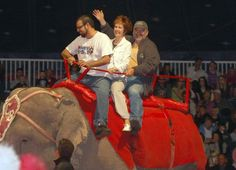 David Turley, mayor of Woodland Park, riding an elephant in the big top on Thursday.