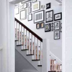 Photograph display on stair case.