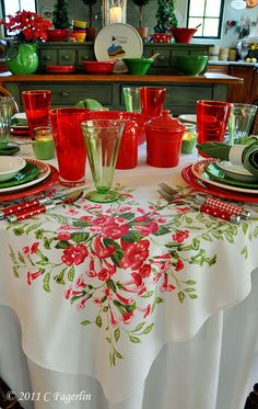 Green and red Fiesta, polka dot and gingham silverware, green depression glass with floral tablecloth.