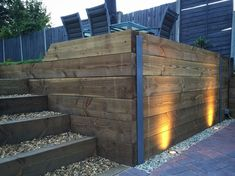 Finished retaining sleeper wall, steps, block paving driveway and exterior LED garden lighting Sleeper Retaining Wall, Retaining Wall Steps, Garden Retaining Wall, Landscaping Retaining Walls, Retaining Wall Lights, Railroad Tie Retaining Wall, Stone Landscaping, Front Yard Walkway, Front Yard Landscaping