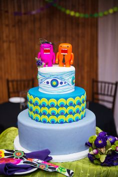 What a fun cake from Laura & David's color-filled art gallery wedding