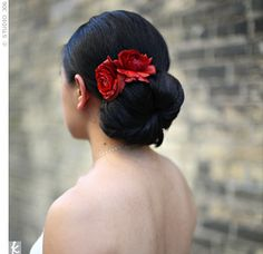 Mandy, who's Vietnamese, opted not to wear a traditional red gown, but she incorporated the lucky color in her outfit by accenting her low chignon with ranunculus.