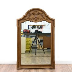 This accent mirror is featured in a solid wood with a glossy stained maple finish. This mirror has a curved top, carved trim and a top acanthus leaf detail. Great piece for decorating an entryway or mantle! #bohemian #decor #mirror #sandiegovintage #vintagefurniture