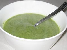 Gwyneth Paltrow's GOOP Broccoli and Arugula Soup 1 tablespoon olive oil 1 clove garlic, thinly sliced 1/2 yellow onion, roughly diced 1 head broccoli, cut into small florets (about 2/3 pound) 2 1/2 cups water 1/4 teaspoon each coarse salt and freshly ground black pepper 3/4 cup arugula (watercress would be good, too) 1/2 lemon