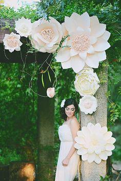 Paper flower themed wedding backdrop