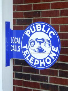 Double-sided Public Telephone sign.