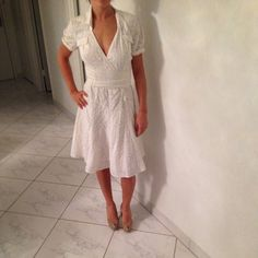 Gorgeous white dress by Diane Von Furstenberg!! Very cute white dress criss cross and ties in the back, has two pockets in the front... Has been worn, but is in great condition!!! Diane von Furstenberg Dresses