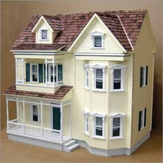 Yellow Victorian Dollhouse.. always wanted one of these. My granddaughter needs one of these... at my house... to play with... of course...  I do need to get a granddaughter....