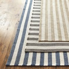 I think this would be a great rug option.  The stripe is a classic enough pattern, that it wouldn't compete with the other patterns in the room.
