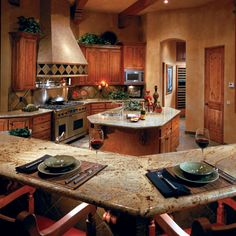 Golden Wave granite countertops from Arizona Tile give this kitchen a warm feel