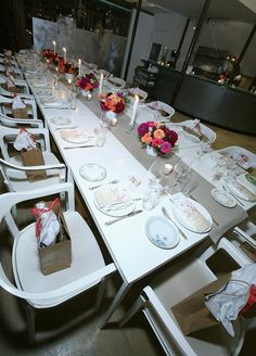This elegant table décor, with floral centerpieces and long white candlesticks, created a gorgeous setting to celebrate Padma Lakshmi's New York City birthday party.