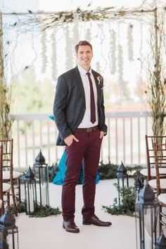 Burgundy pants and tie with gray jacket -- rustic fall wedding attire for a groom