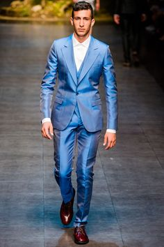 """SPRING 2014 MENSWEAR Dolce & Gabbana /  Domenico Dolce and Stefano Gabbana have found a perfect formula: Sicily as an inspiration for clothes modeled on the catwalk by Sicilians themselves. The sweet authenticity of the idea has powered their last few collections for men, and when cynics in today's audience sighed, """"Oh no, not again,"""" you wanted to slap them. Or torture them by passing on Gabbana's confident declaration: """"There is so much in Sicily, we could be doing this forever."""""""