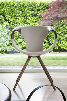 Up-chair by Tonon: new version in soft touch material with solid wood armrests