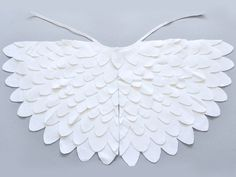 White bird wing cape for kids. Bird dress up wings set for toddlers and young children. Halloween or Carnival dress up bird wing cape costume accessory.