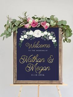 This navy and gold wedding welcome sign features illustrated flowers with modern type for a fun, chic look. You get to customize this wedding welcome sign with your names, date, and the colors and fonts of your choice.