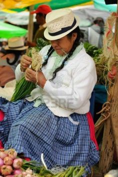 15792308-ecuador-gualaceo--august-22-ecuadorian-ethnic-women-in-national-clothes-selling-agricultural-product.jpg (798×1200)