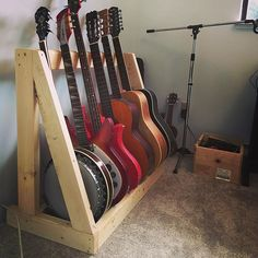 Guitar rack from construction lumber and poly. An older gentleman asked what I was making said you must have a lot of guitars tried to convince me to buy a real drill press then stood in silence for a minute before heading back to his wife. I think his name was Scott. #guitarrack #guitar #banjo #diy #ukelele #scott #sunshinecoastbc