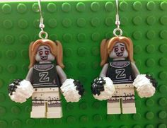 1 pair of handcrafted, Zombie Cheerleader inspired earrings. These are made with nickel-free, surgical steel, fish hook style earrings.  Check out our shop for other Lego inspired jewelry pieces.