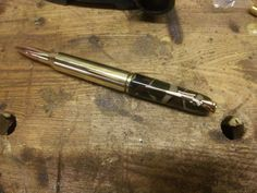.338 lapua Magnum with gold scoped rifle pen clip and DPM top section by www.pomd.co.uk