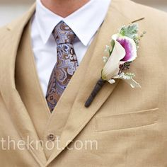 The calla lilies in the groom's boutonniere matched perfectly with the tan suit. Photo by Jen Kroll Photography