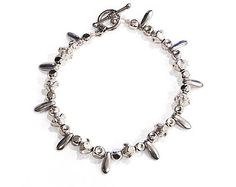 Bracelet, All pieces Silver Plated, Silver Plated Clasp, 7 inches long, Round beads hollow and textured