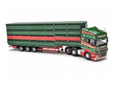 This Scania R Livestock Transporter (Valley Transport) Diecast Model Lorry is Green and features working wheels. It is made by Corgi and is 1:50 scale (approx. 34cm / 13.4in long).    The original company of A Redpath & Son was formed with one 32 tonne Arctic in 1955 moving livestock and agricultural products within the Scottish Borders.  Expansion followed and in 1994 the company became Valley Transport with a fleet of 10 vehicles ranging from 7½ ton trucks to Artics.  At this time it was…