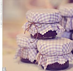 Homemade jam favors. We already decided to do this but I love the fabric on top!