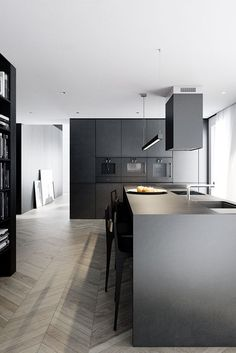 Great floor choice with cool moody cabinet / worktop combo