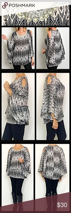 """Dolman Cold Shoulder Tribal Blouse Top S M L One of a kind top featuring embellished neckline (pearls & silver sequins), flutter dolman sleeves & cold shoulders. Amazingly gorgeous, sexy & feminine in an ivory & black tribal print!  Wrinkle free 100 % Polyester S M L  Small Bust 32-34 Length 27"""" Medium Bust 34-36 Length 28"""" Large Bust 36-38 Length 39"""" Tops Blouses"""