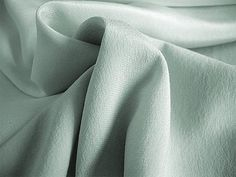 """Another top garment silk, Crepe de Chine (French for """"Crepe from China) is very lightweight and known for its 'pebbly' appearance, which is achieved by twisting some fibers clockwise and others counterclockwise then weaving these twisted fibers together. Both sides of the fabric look exactly the same. It doesn't ravel as easily as other types of silk, but can tear if not handled with care."""