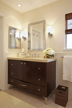 Master bath renovation: cream subway tile, glass mosaic tile, limestone floor, curved vanity, Kohler fixtures, Kohler sink, quartz countertop, woven wood shade. For more inspo, check out http://www.susancorrydesign.com/portfolio/