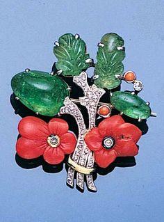 An art deco coral, emerald and diamond brooch, circa 1925. (bonhams.com)