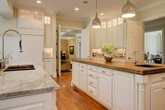 Traditional Kitchen with Craft Art Chestnut Wood Countertop, Hardwood floors, Built-in bookshelf, Crown molding, French doors