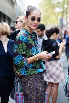 ...the African prints. The mix of colors and prints makes it so interesting. #the sartorialist