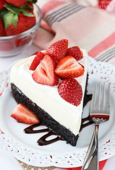 Strawberry Brownie Cheesecake -- A moist and chewy brownie topped with no bake vanilla cheesecake, whipped cream and fresh strawberries! Delicious!