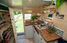 view from loft bed of kitchen in converted van