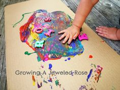 Magnetic painting with letters and a magnetic wand.  A fun way for little ones to learn their name