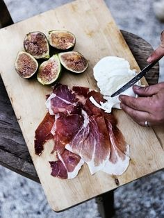Some of the best food in the world! Fresh figs, cheese and prosciutto.... just a glass of wine and my world is complete!