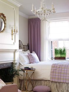 Different shades of lavender, coupled with a tan dust ruffle and lavender-and-tan plaid on the bed, work beautifully with the creamy bedroom walls. The green in the potted plant is a perfect accent. (Photo: Inspired Design) Decor, Guest Room, Curtains, Guest Bedrooms, Window Treatment, Fireplaces, Colors, French Country, Purple Bedrooms