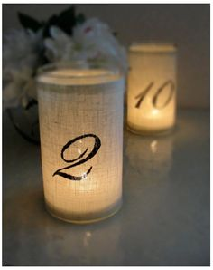 wedding candle wraps - table numbers/seating arrangements???