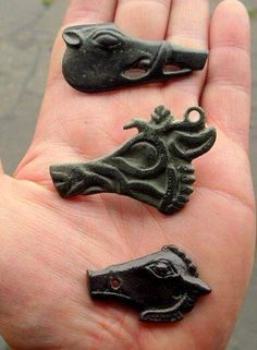 Ancient Celtic bronze boar's head brooches and amulets.