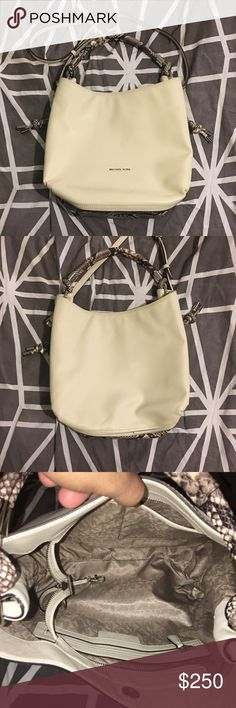 Rare Michael kors ecru leather Isabella bag Like brand new rare Michael kors python bottom zip expandable bag. In great shape and only used once for a few days. Comes with crossbody strap Michael Kors Bags Shoulder Bags