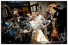 Wedding day exit with streamers, poppers : Amber Ford Photography