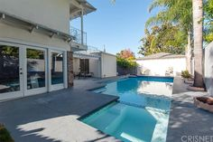 Property 4940 Alcove Avenue, Valley Village, CA 91607 - MLS® #SR15254992 - Price reduced $65,000! Wonderful four bedroom + maids Valley Village pool/spa home located on a corner lot. With four bed
