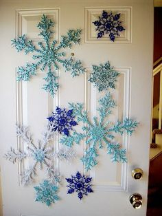 Boost the holiday cheer with door decorations that call out the season. Today in this post, we have rounded up some creative and festive DIY Christmas door decoration ideas for your inspiratio Christmas Snowflakes, Noel Christmas, Winter Christmas, Diy Snowflakes, Winter Snow, Blue Christmas Decor, Hello Winter, Turquoise Christmas, Christmas Garlands